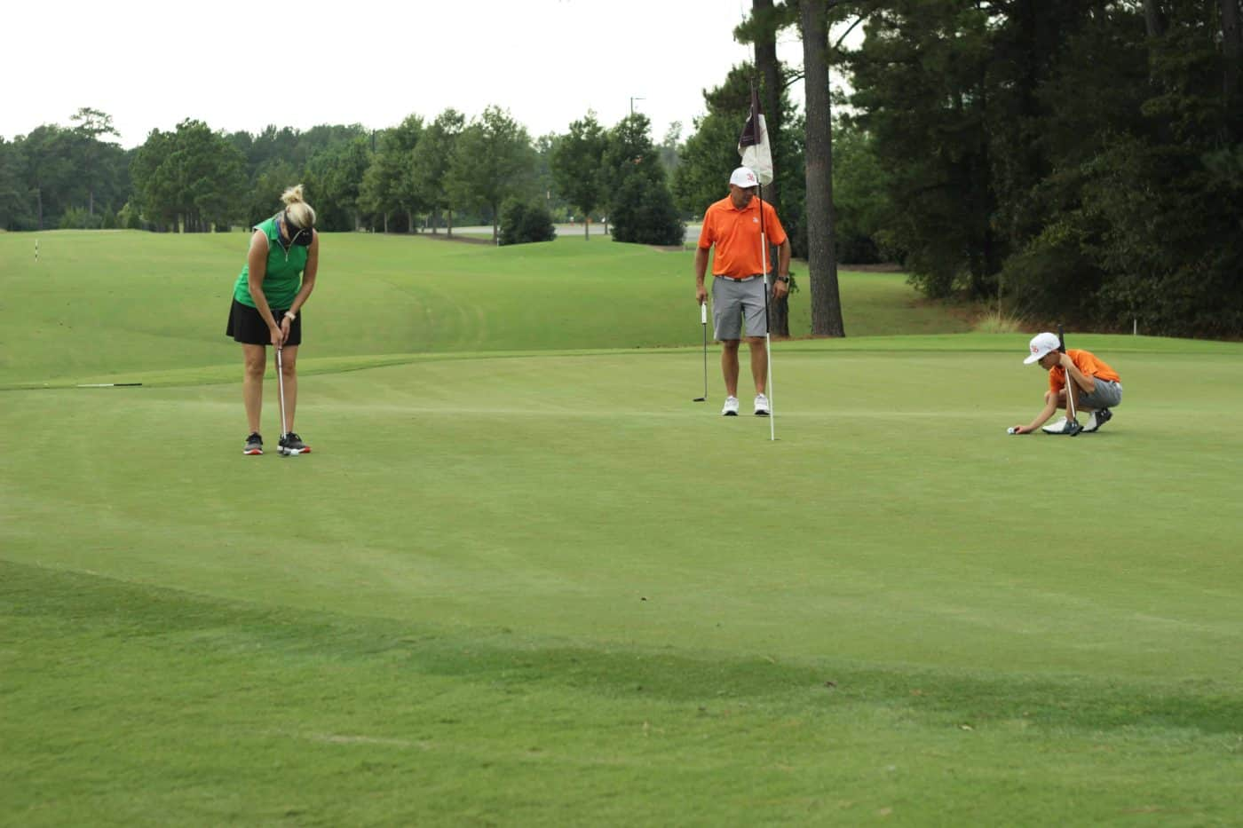 A family playing golf together