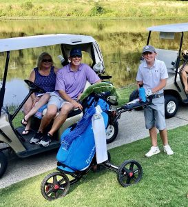 Family watching their son playing golf in an Op 36 9-hole event