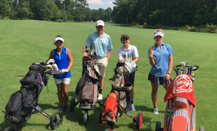 Group of juniors posing for a picture during their round of golf