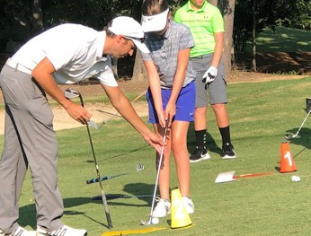 Op 36 coach helping junior with their chipping
