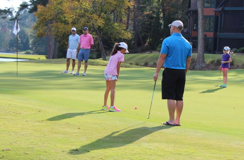 Father caddying for daughter in Op 36 Event