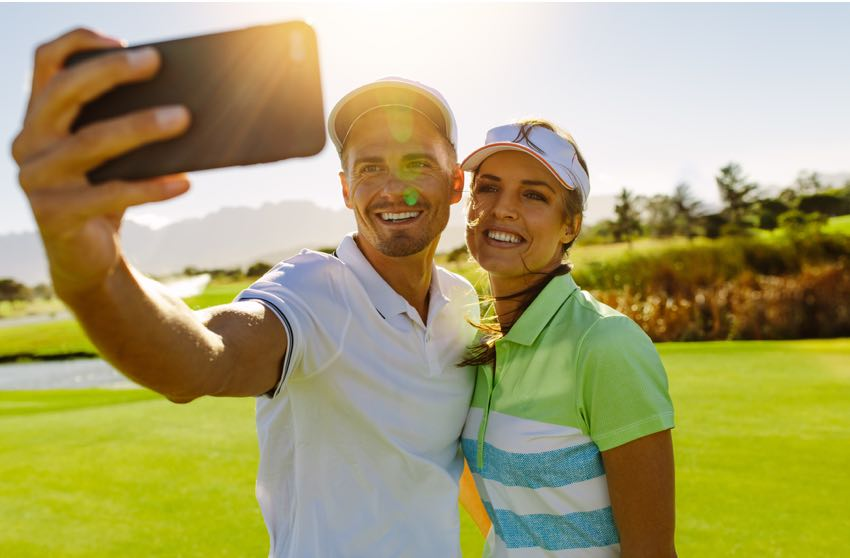 Couple taking a selfie after a round of golf