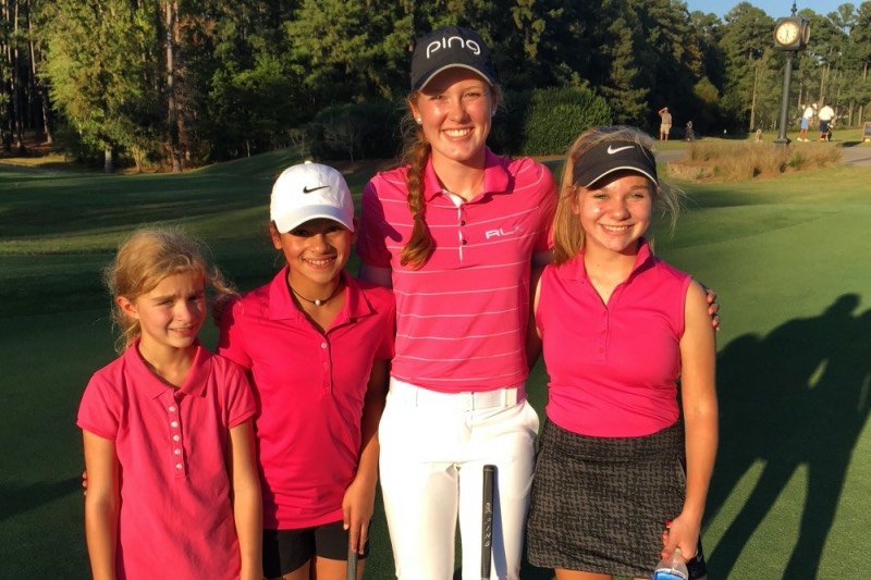 College golfer taking a picture with other junior golfers