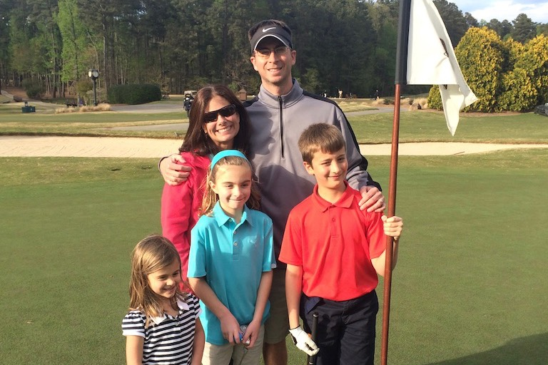 Family of 5 golfing together