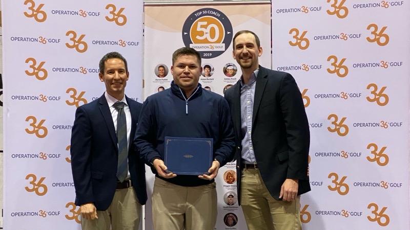 Op 36 Top 50 Coach Ryne Burnett receiving his award