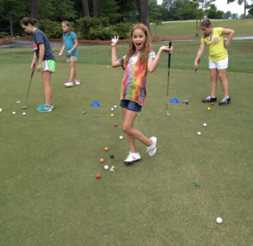 Junior Golfer Practicing Putting