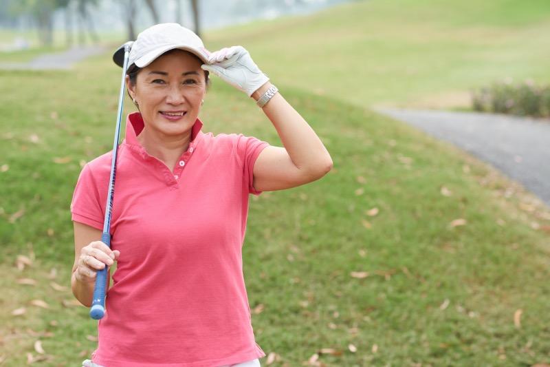 Female golfer getting ready to go play golf