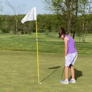 #1inaMillion Golfer Ainsley Hargens holing a putt